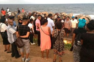 Religious group holds vigil for slain bishop