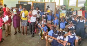 Soca artiste 'R3cka'  donates back to school supplies to students, schools